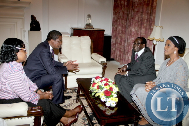 President Edgar Lungu confers with  Zimbabwe's President  Robert Mugabe at State House on April 28,2015. Looking on are Zimbabwe's First Lady Esther Lungu and Zimbabwe's First Lady Grace Mugabe at State House in Harare -Picture by THOMAS NSAMA