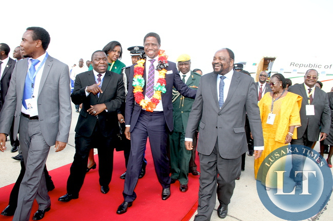President Edgar Chagwa Lungu share alight moment   with Zimbabwe minister of foreign Affairs Simbarashe Mumbengegwi on arrival at Harare International Airport for SADC Summit on April 28,2015 -Picture by THOMAS NSAMA