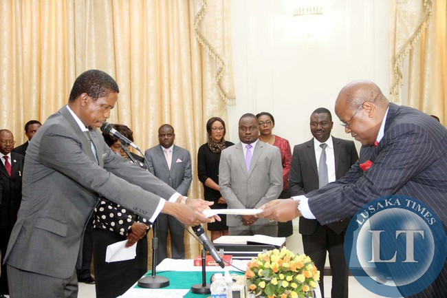 President Edgar Lungu receives an affidavit of Oath from Newly appointed Southern Province Permanent Secretary Sibanze Simuchoba during the Swearing-In-Ceremony at State House on April 22,2015 -Picture by THOMAS NSAMA