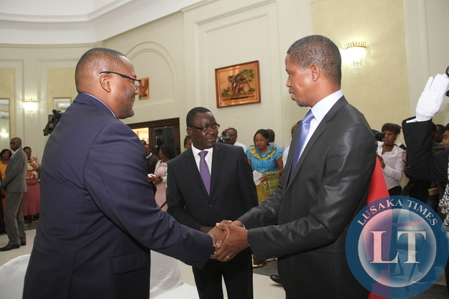 President Edgar Lungu congratulates Zambia's High Commissioner to South Africa Emmanuel Mwamba (r) during the swearing -In-Ceremony at State House on May 4,2015 -Picture by THOMAS NSAMA