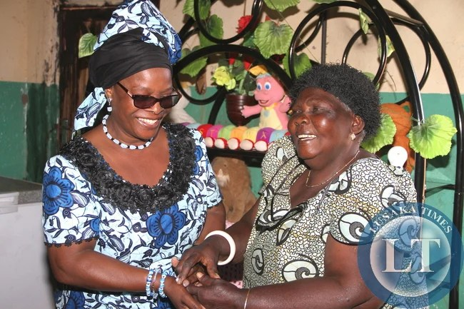 First Lady Esther Lungu with Chieftainess Nyanje when she paid a courtesy call on her at the palace in Sinda District on May 20,2015. The First Lady is in Eastern Province for the Outreach Programme for People with Special needs- Pictures by THOMAS NSAMA