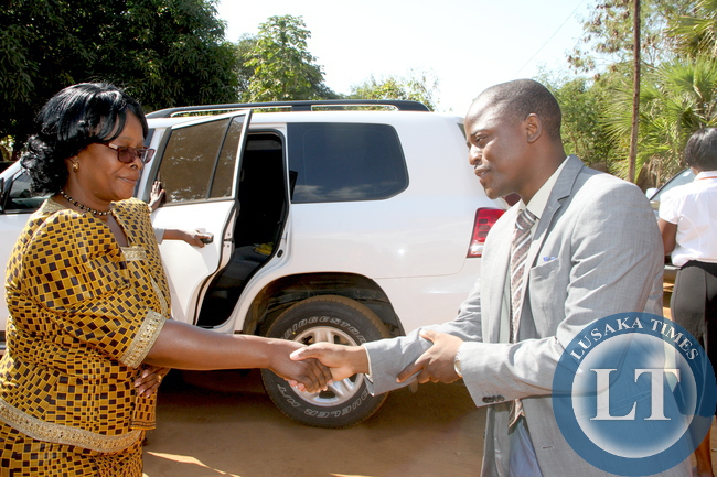 First   Lady Esther Lungu welcomed by Nyimba District Representative Dr Mubbunu Malambo on arrival  at  Nyimba District Hospital where she visited patients on May 19,2015. The First Lady is in Eastern Province for the outreach Programme for People with Special needs  –Picture by THOMAS NSAMA