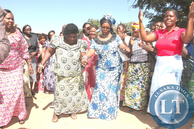 First Lady Esther Lungu and  Chieftainess Nyanje join women in dancing  when she paid a courtesy call on her at the palace in Sinda District on May 20,2015. The First Lady is in Eastern Province for the Outreach Programme for People with Special needs- Pictures by THOMAS NSAMA