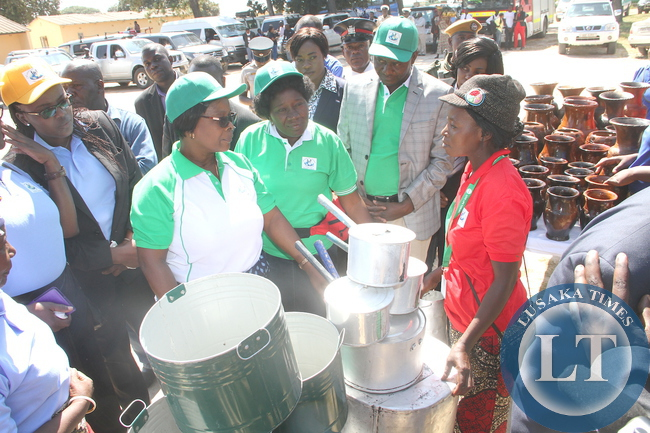 First Lady Esther Lungu  talks to Mary Bwalya when she toured stands during the Commemorations of the International Day of Families  in Kapiri Mposhi on May 15,2015 -Picture by THOMAS NSAMA