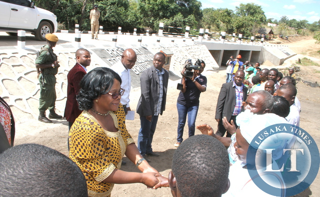 First Lady Esther Lungu greets PF officials on arrival in Hofmeyer area where she inspected President Edgar Lungu Bridge that was  constructed by Nyimba District Council . This was in Nyimba District, Eastern Province on May 20,2015 -Picture by THOMAS NSAMA