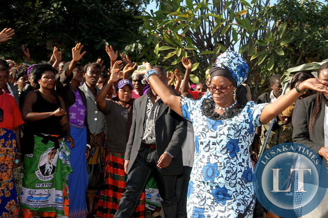 First Lady Esther Lungu waves after addressing women at Sinda Motel in Eastern Province of Zambia on May 20,2015 -Picture by THOMAS NSAMA