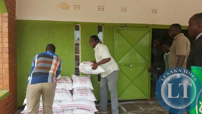 UPND President Hakainde Hichilema  offload mealie meal at a shop in Linda compound