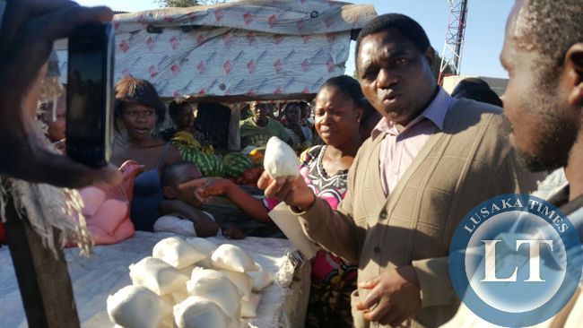 UPND president Hakainde Hichilema interacts with marketeers in Marapodi township