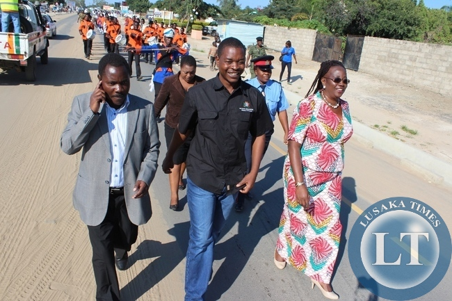 Western Province Minister Poniso Njeulu flanked by Community Development Minister Emerine Kabanshi (r) and Western Province Assistant Secretary Sineva Kambenja (l) leading the marchers during Labour Day celebrations in Mongu on Friday