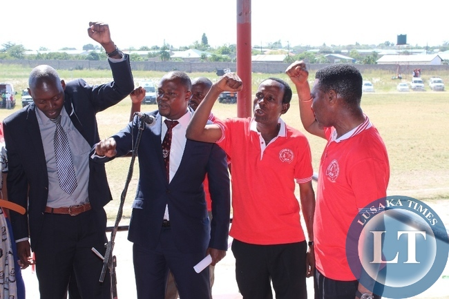 Western Province labour unionists sing a song of solidarity during Labour Day Celebrations at Mongu Stadium in Mongu on Friday.