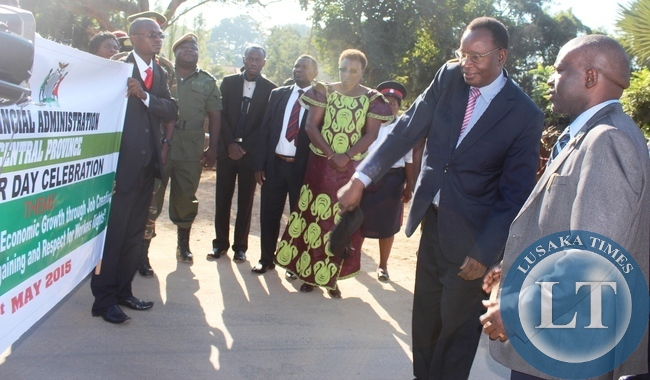 Health Minister Dr Joseph Kasonde (second right) flagging off this year's International Labour day celebrations in Kabwe today. Looking on (centre ) is Central Province Permanent Secretary Edwidge Mutale and Kabwe DC Patrick Chishala on the right.