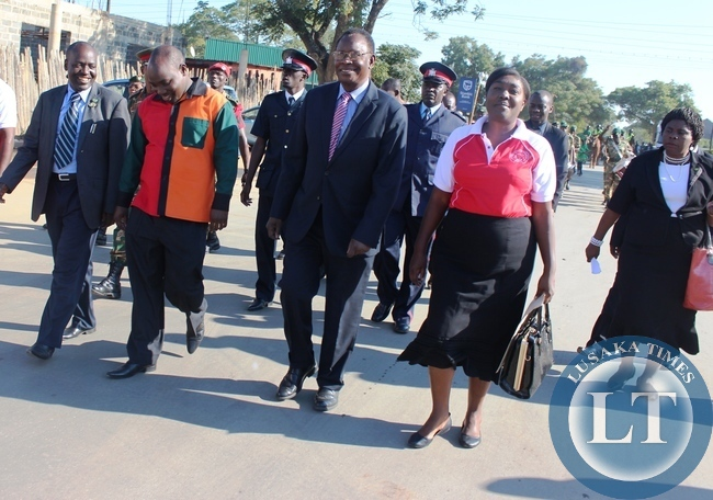 From left, Kabwe District Commissioner Patrick Chishala, Central Province Deputy PS Ronald Sinyangwe and Health Minister Dr Joseph Kasonde marching to Godfrey Chitalu Stadium during this year's International Labour Day in Kabwe