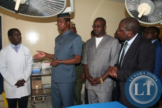 -President Edgar Lungu talks to Kalene mission medical doctor in charge Felix Chibwe (l) during the tour of a theater unit on Thursday in Ikeleng'e as North-Western province minister Dawson Kafwaya and Health deputy minister Dr Chilufya Chitalu ( r) look on