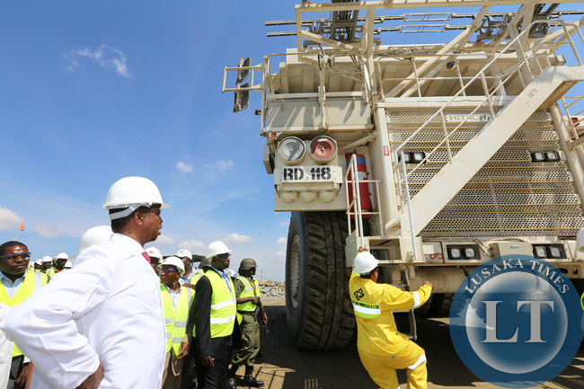 President Edgar Lungu during the Tour of Kansanshi Mine PLC in Solwezi on Friday watches Female Grace Katambi Mine Truck driver 168tonnes 15-05-2015 Picture EDDIE MWANALEZA /STATE HOUSE.