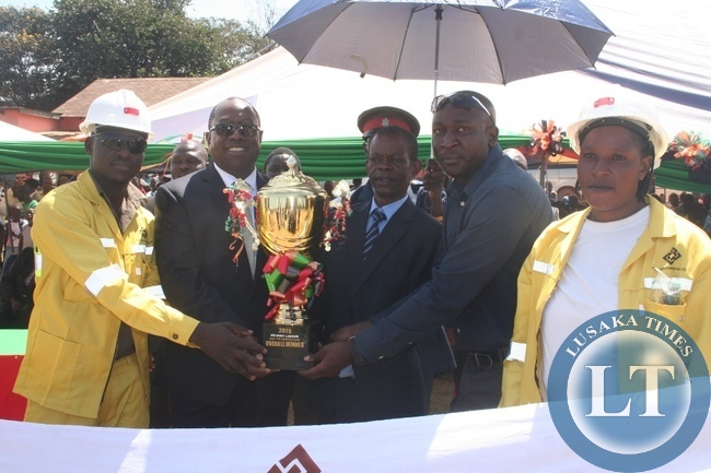 First Quantum Mineral Operations (FQMO) emerged the overall best winners of 2015 labour day celebrations in Solwezi. Above, chiefs and traditional affairs minister Dr Joseph Katema (second right) hands over the trophy to Kansanshi mine public relations manager Godfrey Msiska on Friday in Solwezi.
