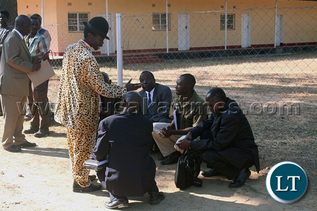 Chief Ishima talks to the Lunda Indunas before the meeting with President Edgar Lungu ...