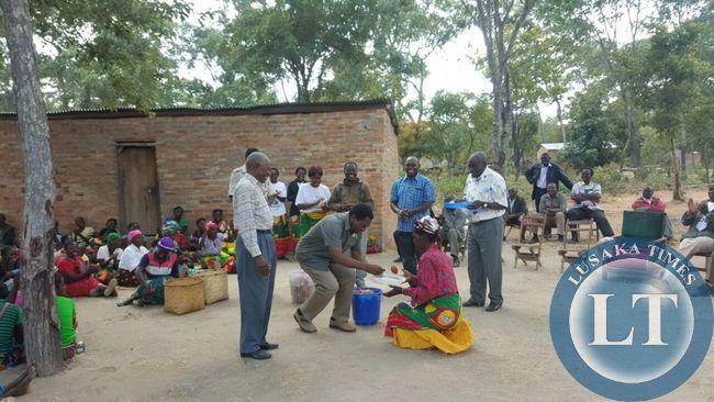 UPND president Hakainde HIchilema buying and eating vitumbuwa at Nyakayokoli village in Malambo