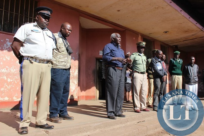 Home Affairs Deputy Minister Panji Kaunda (third from the far left) addressing prisoners (not in picture) at Livingstone Central Prison on Monday