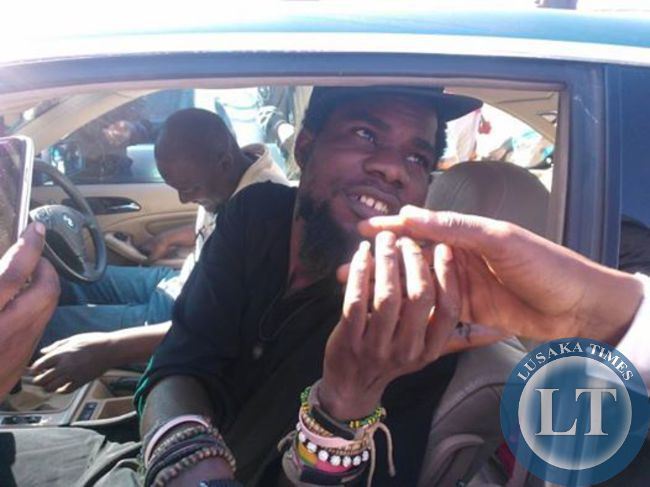 FILE: Pilato being whisked away after court adjourned
