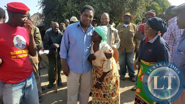 UPND president Hakainde Hichilema talks to an elderly woman in Mulobezi