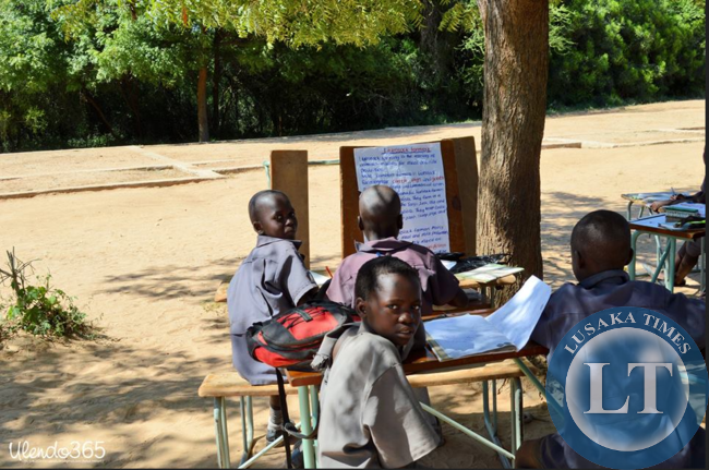 Children learning under a tree at Sialwala Primary School  located in Sinazongwe,due to lack of classrooms.
