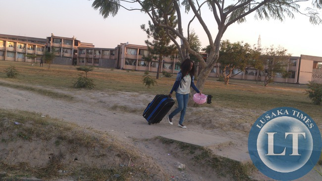 A student at the Copperbelt University sadly walks away after the PF Government shut down one of Zambia's highest learning Institutions