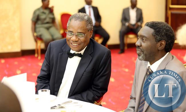 Emmanuel Chenda with Mr Jimmy Akena Dr Obote Son at Entebbe Statehouse Banquet