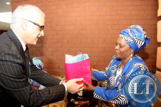 First Lady Esther Lungu receives a gift from The Aga Khan University Hospital Chief Executive  officer  Shawn Bolouki  during  the tour of Aga Khan University Hospital in Nairobi, Kenya on July 20,2015 -Picture by THOMAS NSAMA