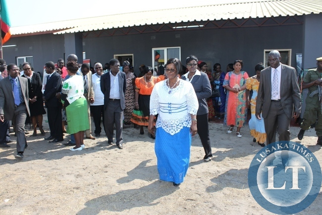 First Lady Esther Lungu (c) leaves the new Lewanika General Hospital Relatives' Shelter after commissioning it in Mongu