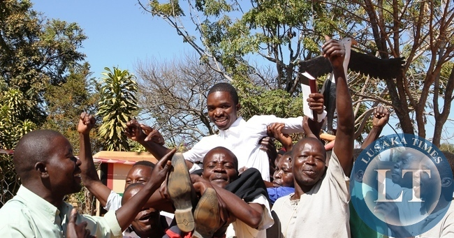 NAREP Candidate Morgan Mwewa lifted shoulder high by his supporters after successfully filing in nominations as aspiring candidate for Bangweulu constituency in Samfya