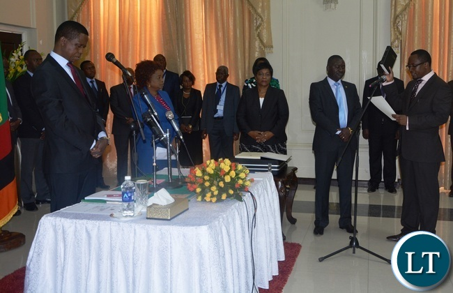 Richwell Siamunene being sworn in as Defence Minister by President Edgar Lungu during the swearing in Ceremony at State House
