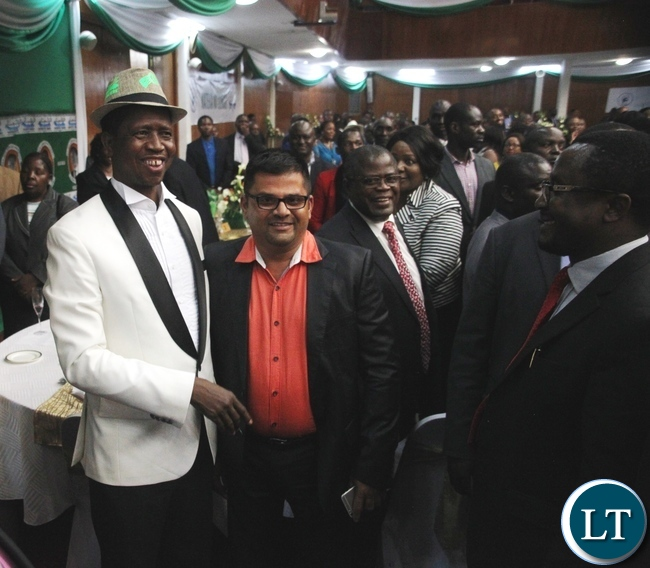 President Edgar Lungu with Nyimba Investments Limited Marketing Manager Siraaj Ginwala During the meet the President Fundriasing dinner at Mulungushi Conference center