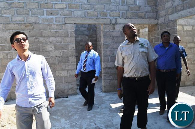 Eastern Province Minister Malozo Sichone,China Jiangxi Project Manager Cai Jiado Nash, Lundazi acting District Commissioner Mukule Banda and Provincial Deputy Permanent Secretary Patrick Mwanawasa when he inspected a K44 million project of a boarding school under construction in Chasefu of Lundazi District