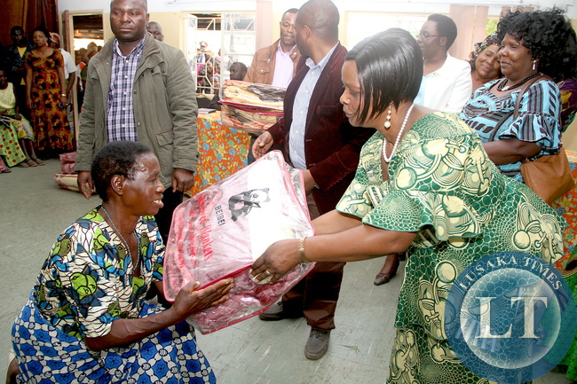 First Lady Esther Lungu donates blankets to the aged at Lewanika General Hospital where she visited women Clubs  in Mongu District in Western Province on Thursday, August 13,2015. The First L:day is in Western Province on the Outreach Programme for People with Special needs  -Picture by THOMAS NSAMA