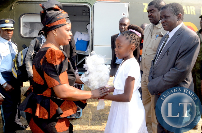 First Lady Esther Lungu receives flowers Lushomo Beenzu on arrival in Lukulu District for the outreach programme for People with Special needs on Friday, August 14,2015 -Picture by THOMAS NSAMA