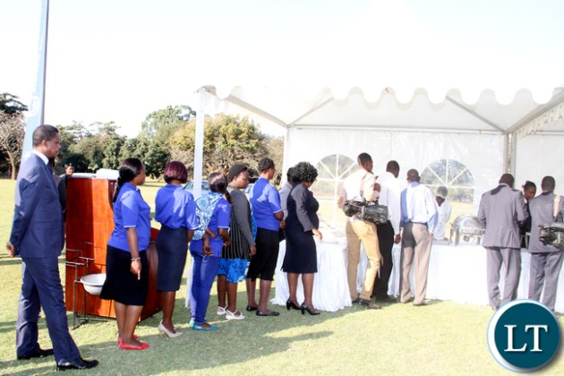 President Edgar Chagwa Lungu join a queue for Lunch during the junior achievers Mentorship Programme at State House on August 10,2015 -Picture by THOMAS NSAMA / STATE HOUSE