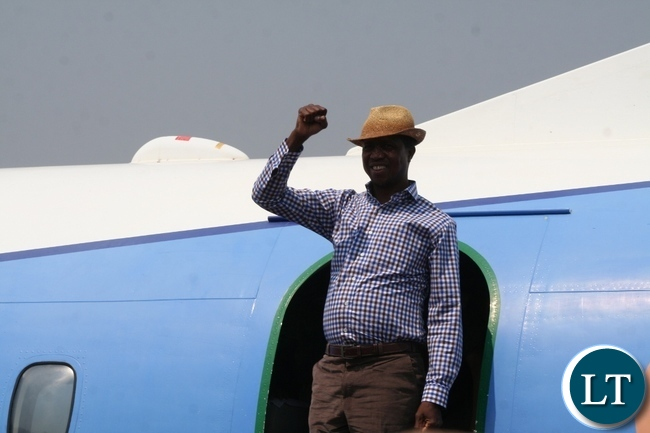 President Lungu flashing PF symbol upon arrival at Solwezi airport today