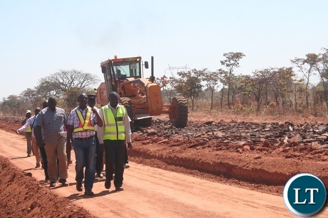 State House permanent secretary Emmanuel Chilubanama (in glasses) during the inspection of the rehabilitation of works on Lot 1 of the Solwezi –Chingola road being undertaken by China Geo Engineering corporation in Solwezi