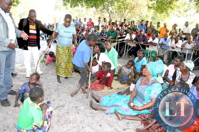 First Lady Esther Lungu (R-sitting) when she visited victims of Konzo disease caused by excessive consumption of cassava in Lwatembo area in Nalikwanda Constituency, Mongu District. According to Dr Francis liywali of Mongu District says many people of Lwatembo area have become paralysis due to cyanide poisoning, caused by excessive consumption of un properly processed cassava -Pictures by THOMAS NSAMA /STATE HOUSE