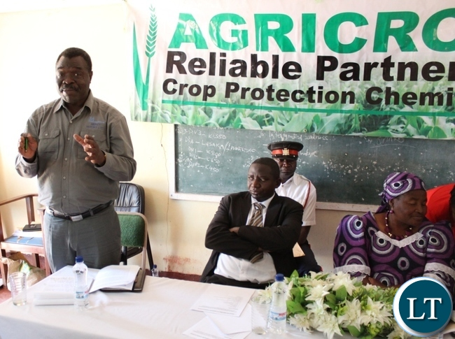 Zambia National Farmers Union (ZNFU) director Richard Lisimba (Standing) with Acting Serenje district Commissioner Kenny Mungendenge and Serenje District Farmers association (SDFA) Chairperson Grace Kambilombilo during the SDFA 22nd AGM held at Serenje Farmers Training Centre