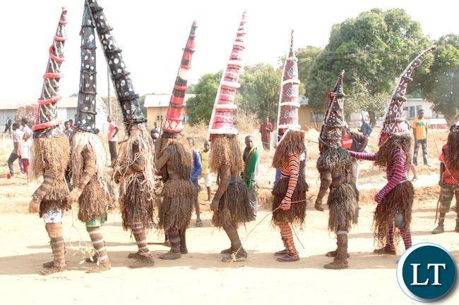 some makishi during the likumbi lya mize ceremony in zambezi