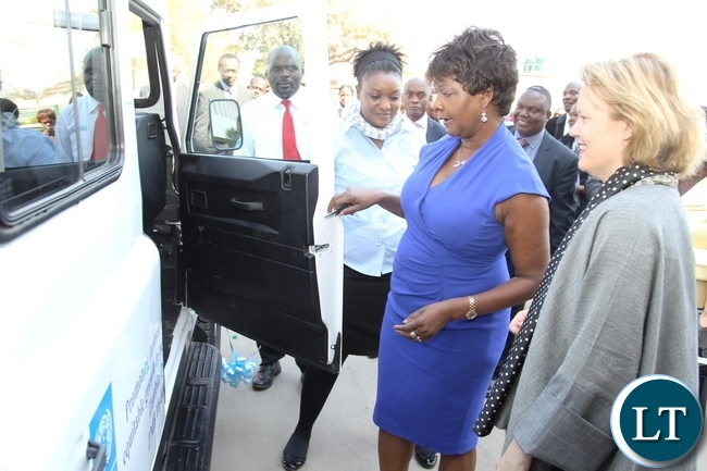 Minister of Commerce and Trade Margaret Mwanakatwe (2nr) and UNDP Country Co-odinator Janet Rogan admiring the equipment shortly hand over  ceremony at Government Complex