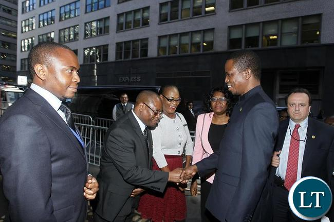 Edgar Chagwa Lungu (second from right) being welcomed by his Special Assistant for Economy and Development Affairs Hibeene Mwiinga (second from left) at Palace Hotel in New York on Thursday,September 24,2015. PICTURE BY SALIM HENRY/STATE HOUSE ©2015