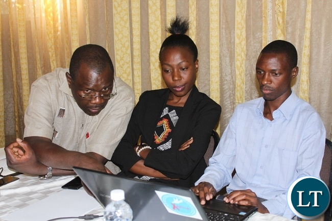 University of Zambia Institute of Economic and Social Research Fellow II Dr. Mushimba Nyamazana (l) sharing notes with Mongu youths participating in the Validation workshop on Content and implementation of the Revised National Employment and Labour Market Policy for 2016-2020 in Mongu