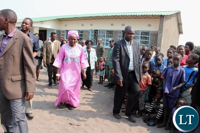 Vice President Inonge Wina (c) after the official opening of a 1x 2 class room block worth k160,000 at Kataba Primary School in Nalolo District