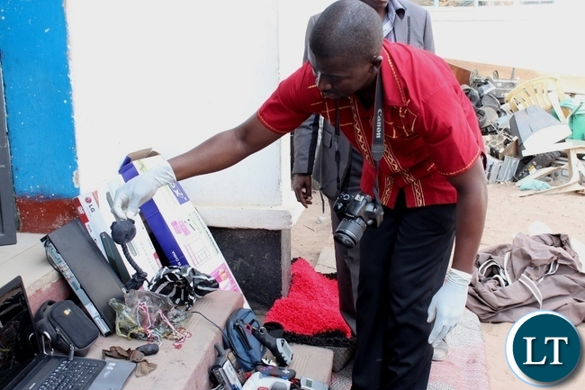 A police officer displays some traditional charms used by suspected criminals at Mongu Central Police
