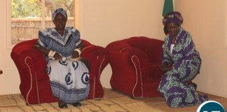 Vice President Inonge Wina (r) kneels before Her Royal Highness Litunga La Mboela (l) of Lwambi Chiefdom inside the Kashandi (Conference Room) during the courtesy call in Nalolo District