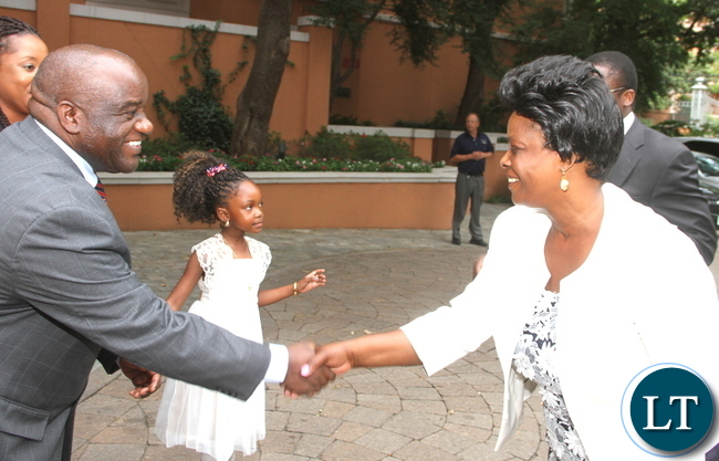 First Lady Esther Lungu greets Councilor Economics at Zambia's Embassy to the United States James Chisenga (L) on arrival in Dallas-Texas for the Global Women's network summit organized by the George W. Bush Institute on Sunday, September 20,2015 -Picture by THOMAS NSAMA