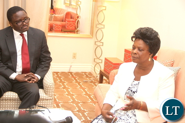 First Lady Esther Lungu flanked by Zambia's ambassador to the United States Palani Mulonda (l) during a media briefing on arrival in Dallas-Texas for the Global Women's network summit organized by the George W. Bush Institute on Sunday, September 20,2015 -Picture by THOMAS NSAMA