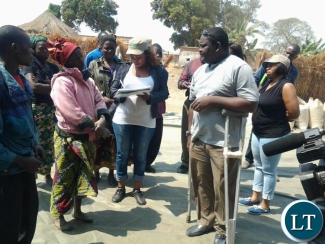 FOOD Reserve Agency executive director Chola Kafwabulula talking to a farmer at Chiwoko FRA depot in Chipata